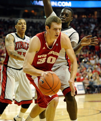 LAS VEGAS - NOVEMBER 20:  Jon Leuer #30 of the Wisconsin Badgers tries to get away from defenders Tre'Von Willis (L) #33 and Brice Massamba #12 of the UNLV Rebels during their game at the Thomas & Mack Center November 20, 2010 in Las Vegas, Nevada. UNLV w