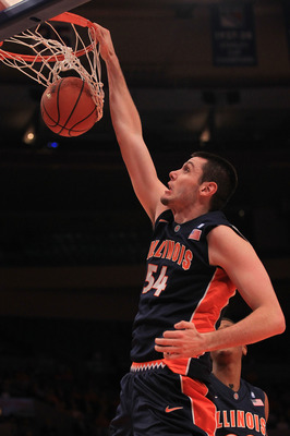 NEW YORK - NOVEMBER 18: Mike Tisdale #54 of the Illinois Fighting Illini slam dunks against the Texas Longhorns during the 2k Sports Classic at Madison Square Garden on November 18, 2010 in New York, New York.  (Photo by Chris McGrath/Getty Images)