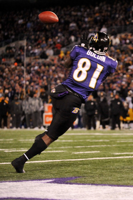 BALTIMORE, MD - DECEMBER 05:  Wide receiver Anquan Boldin #81 of the Baltimore Ravens catches a pass to score a touchdown against the Pittsburgh Steelers during the first quarter of the game at M&amp;T Bank Stadium on December 5, 2010 in Baltimore, Maryland. 