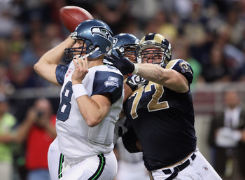 ST. LOUIS - OCTOBER 03:  Chris Long #72 of the St. Louis Rams pressures Matt Hasselbeck #8 of the Seattle Seahawks on October 3, 2010 at Edward Jones Dome in St. Louis, Missouri. The Rams defeated the Seahawks 20-3.  (Photo by Elsa/Getty Images)