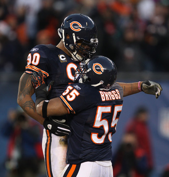 CHICAGO - NOVEMBER 28: Lance Briggs #55 of the Chicago Bears celebrates a sack by Julius Peppers #90 against the Philadelphia Eagles at Soldier Field on November 28, 2010 in Chicago, Illinois. (Photo by Jonathan Daniel/Getty Images)