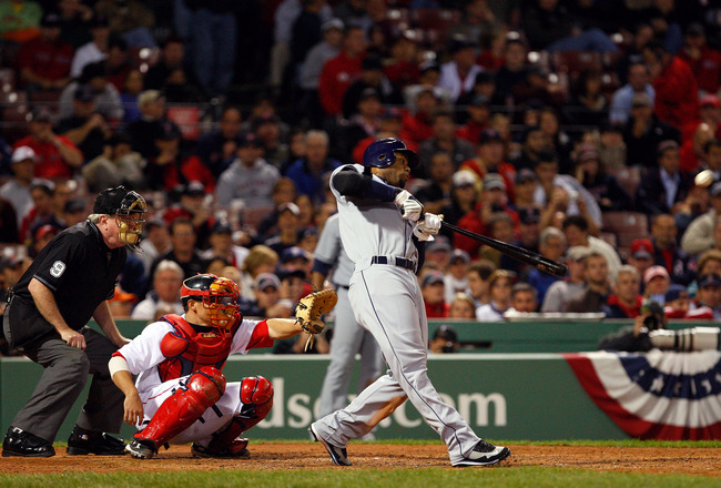 BOSTON - OCTOBER 14:  Carl Crawford #13 of the Tampa Bay Rays hits a triple against the Boston Red Sox in game four of the American League Championship Series during the 2008 MLB playoffs at Fenway Park on October 14, 2008 in Boston, Massachusetts.  (Phot