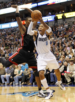 DALLAS - NOVEMBER 27: Shawn Marion #0 of the Dallas Mavericks drives by Chris Bosh #1 of the Miami Heat on November 27, 2010 at the American Airlines Center in Dallas, Texas. NOTE TO USER: User expressly acknowledges and agrees that, by downloading and or