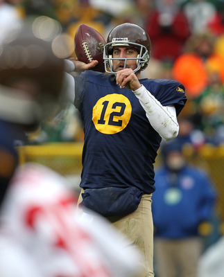 GREEN BAY, WI - DECEMBER 05: Aaron Rodgers #12 of the Green Bay Packers throws a pass against the San Francisco 49ers at Lambeau Field on December 5, 2010 in Green Bay, Wisconsin. The Packers defeated the 49ers 34-16. (Photo by Jonathan Daniel/Getty Image
