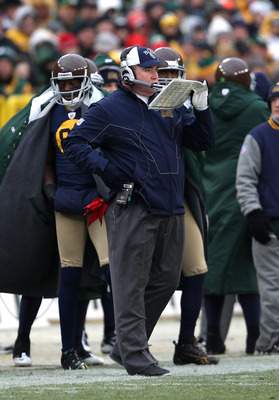 GREEN BAY, WI - DECEMBER 05: Head coach Mike McCarthy of the Green Bay Packers calls an offensive play against the San Francisco 49ers at Lambeau Field on December 5, 2010 in Green Bay, Wisconsin. The Packers defeated the 49ers 34-16. (Photo by Jonathan D