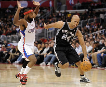 LOS ANGELES, CA - DECEMBER 01:  Richard Jefferson #24 of the San Antonio Spurs dribbles around Baron Davis #5 of the Los Angeles Clippers at the Staples Center on December 1, 2010 in Los Angeles, California.  NOTE TO USER: User expressly acknowledges and