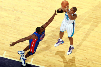 NEW ORLEANS, LA - DECEMBER 08:  David West #30 of the New Orleans Hornets shoots the ball over Jason Maxiell #54 of the Detroit Pistons at the New Orleans Arena on December 8, 2010 in New Orleans, Louisiana.  NOTE TO USER: User expressly acknowledges and