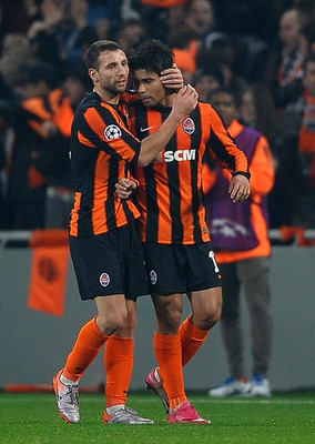 DONETSK, UKRAINE - NOVEMBER 03:  Eduardo of FC Shakhtar Donetsk is congratulated on the second goal during the Champions League Group H match between FC Shakhtar Donetsk and Arsenal at the Donbass Arena on November 3, 2010 in Donetsk, Ukraine.  (Photo by