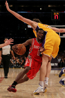 LOS ANGELES, CA - OCTOBER 26:  Aaron Brooks #0 of the Houston Rockets drives with the ball against Pau Gasol #16 of the Los Angeles Lakers during their opening night game at Staples Center on October 26, 2010 in Los Angeles, California. NOTE TO USER: User