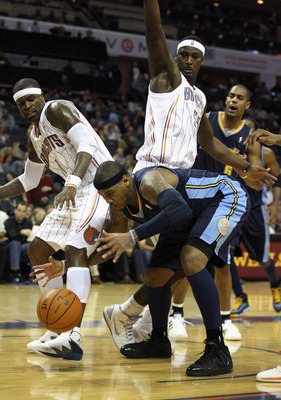 CHARLOTTE, NC - DECEMBER 07:  Carmelo Anthony #15 of the Denver Nuggets battles for a loose ball with Stephen Jackson #1 of the Charlotte Bobcats during their game at Time Warner Cable Arena on December 7, 2010 in Charlotte, North Carolina.  NOTE TO USER: