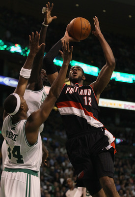 BOSTON - DECEMBER 01:  LaMarcus Aldridge #12 of the Portland Trailblazers tries to shoot around Paul Pierce #34 and Kevin Garnett #5 of the Boston Celtics on December 1, 2010 at the TD Garden in Boston, Massachusetts. The Celtics defeated the Trailblazers