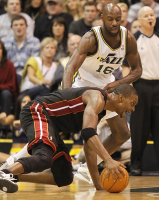 SALT LAKE CITY, UT - DECEMBER 8: Chris Bosh #1 of the Miami Heat falls to the ground as Francisco Elson #16 of the Utah Jazz during the second half of an NBA game December 8, 2010 at Energy Solutions Arena in Salt Lake City, Utah. The Heat beat the Jazz 1