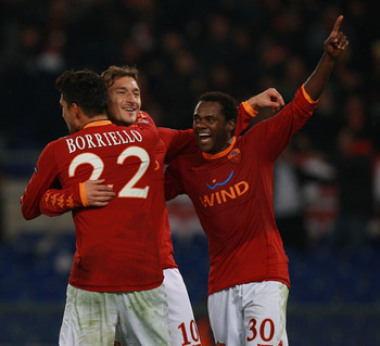 ROME - NOVEMBER 23:  Francesco Totti (C) with his teammates Marco Borriello #22 and Fabio Simplicio (R) of AS Roma celebrates after scoring the third goal during the UEFA Champions League Group E match between AS Roma and FC Bayern Muenchen at Stadio Olim