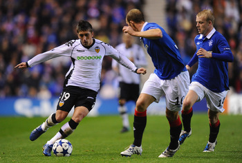 GLASGOW, SCOTLAND - OCTOBER 20:  Pablo Hernandez of Valencia takes on the Rangers defence during the UEFA Champions League Group C match between Glasgow Rangers FC and Valencia at Ibrox Stadium on October 20, 2010 in Glasgow, Scotland.  (Photo by Mike Hew