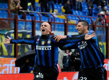 MILAN, ITALY - NOVEMBER 28:  Esteban Cambiasso and Marco Materazzi of FC Internazionale Milano celebrate scoring the first goal during the Serie A match between Inter and Parma at Stadio Giuseppe Meazza on November 28, 2010 in Milan, Italy.  (Photo by Cla