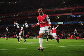 LONDON, ENGLAND - DECEMBER 08:  Theo Walcott of Arsenal celebrates as he scores their second goal during the UEFA Champions League Group H match between Arsenal and FK Partizan Belgrade at the Emirates Stadium on December 8, 2010 in London, England.  (Pho