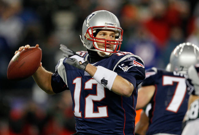 FOXBORO, MA - DECEMBER 06:  Tom Brady #12 of the New England Patriots throws a pass in the first half against the New York Jets at Gillette Stadium on December 6, 2010 in Foxboro, Massachusetts.  (Photo by Jim Rogash/Getty Images)