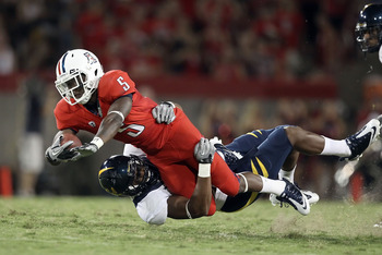 TUCSON, AZ - SEPTEMBER 25:  Runningback Nic Grigsby #5 of the Arizona Wildcats is tackled by Cameron Jordan #97 of the California Golden Bears after a 10 yard reception during the second quarter of the college football game at Arizona Stadium on September