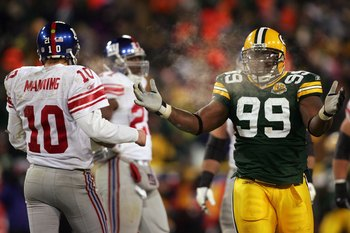 GREEN BAY, WI - JANUARY 20:  Corey Williams #99 of the Green Bay Packers reacts during the NFC championship game against the New York Giants on January 20, 2008 at Lambeau Field in Green Bay, Wisconsin. The Giants defeated the Packers 23-20 in overtime to