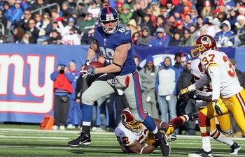 EAST RUTHERFORD, NJ - DECEMBER 05:  Kevin Boss #89 of the New York Giants runs the ball after a reception against the Washington Redskins on December 5, 2010 at the New Meadowlands Stadium in East Rutherford, New Jersey.  (Photo by Jim McIsaac/Getty Image