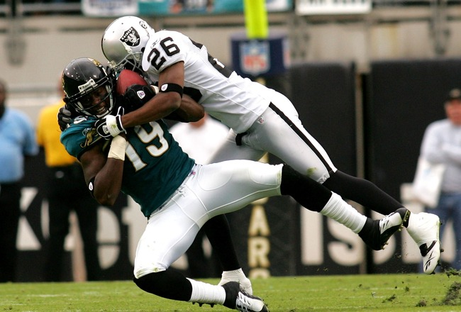 JACKSONVILLE, FL - DECEMBER 23:  Ernest Wilford #19 of the Jacksonville Jaguars is tackled by Stanford Routt #26 of the Oakland Raiders at Jacksonville Municipal Stadium on December 23, 2007 in Jacksonville, Florida.  (Photo by Sam Greenwood/Getty Images)