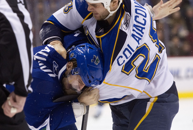VANCOUVER, CANADA - DECEMBER 5: Carlo Colaiacovo #28 of the St Louis Blues connects with a punch on the back of the head of Keith Ballard #4 during fight in the first period in NHL action on December 05, 2010 at Rogers Arena in Vancouver, BC, Canada.  (Ph