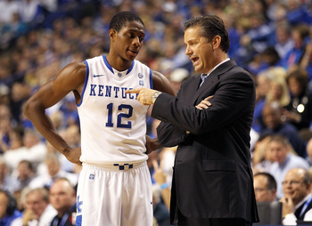 LEXINGTON, KY - NOVEMBER 30:  Brandon Knight #12 of the Kentucky Wildcats talks with Head Coach John Calipari during the game against the Boston University Terriers on November 30, 2010 in Lexington, Kentucky.  (Photo by Andy Lyons/Getty Images)