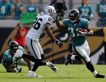 JACKSONVILLE, FL - DECEMBER 23: Maurice Jones-Drew #32 of the Jacksonville Jaguars runs against Stanford Routt #26 of the Oakland Raiders at Jacksonville Municipal Stadium on December 23, 2007 in Jacksonville, Florida.  (Photo by Sam Greenwood/Getty Image