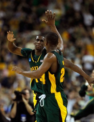 HOUSTON - MARCH 28: Ekpe Udoh #13 of the Baylor Bears celebrates a shot with teammate LaceDarius Dunn #24 against the Duke Blue Devils during the south regional final of the 2010 NCAA men's basketball tournament at Reliant Stadium on March 28, 2010 in Hou