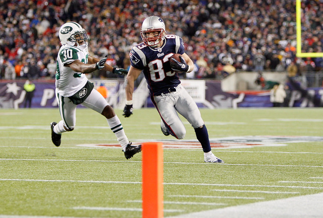 FOXBORO, MA - DECEMBER 06:  Wes Welker #83 of the New England Patriots scores an 18-yard touchdown reception in the third quarter against Drew Coleman #30 of the New York Jets at Gillette Stadium on December 6, 2010 in Foxboro, Massachusetts.  (Photo by J