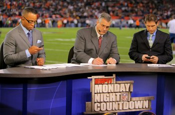 DENVER - NOVEMBER 09:  Matt Millen (C) works on the set of the pregame show for ESPN's Monday Night Football as his co hosts Stuart Scott (L) and Steve Young (R) work on their personal electronic devices as the Pittsburgh Steelers face the Denver Broncos