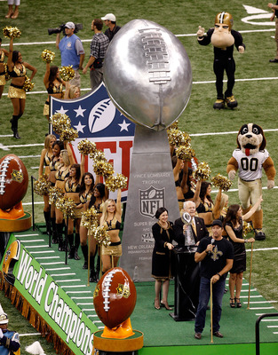NEW ORLEANS - SEPTEMBER 09:  Harry Connick Jr. leads a float out onto the field which carried the Vince Lombardi Super Bowl Trophy which was won last year by the New Orleans Saints prior to the Saints playing against the Minnesota Vikings at Louisiana Sup