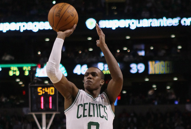 BOSTON, MA - DECEMBER 08:  Rajon Rondo #9 of the Boston Celtics takes a shot against the Denver Nuggets on December 8, 2010 at the TD Garden in Boston, Massachusetts. NOTE TO USER: User expressly acknowledges and agrees that, by downloading and/or using t