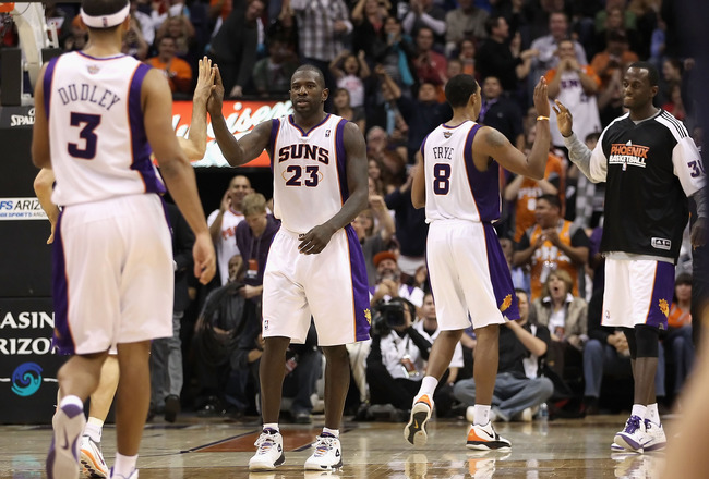 PHOENIX - DECEMBER 03:  Jason Richardson #23 of the Phoenix Suns high fives teammates after scoring against the Indiana Pacers during the NBA game at US Airways Center on December 3, 2010 in Phoenix, Arizona. The Suns defeated the Pacers 105-97. NOTE TO U