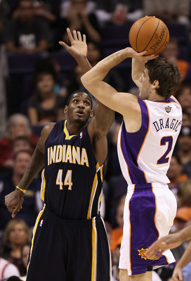 PHOENIX - DECEMBER 03:  Goran Dragic #2 of the Phoenix Suns puts up a shot over Solomon Jones #44 of the Indiana Pacers during the NBA game at US Airways Center on December 3, 2010 in Phoenix, Arizona.  The Suns defeated the Pacers 105-97.  NOTE TO USER: