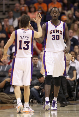 PHOENIX - DECEMBER 03:  Earl Barron #30 of the Phoenix Suns high fives teammate Steve Nash #13 during the NBA game against the Indiana Pacers at US Airways Center on December 3, 2010 in Phoenix, Arizona. NOTE TO USER: User expressly acknowledges and agree