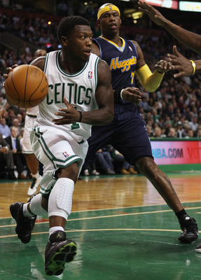 BOSTON, MA - DECEMBER 08:  Nate Robinson #4 of the Boston Celtics drives around Al Harrington #7 of the Denver Nuggets on December 8, 2010 at the TD Garden in Boston, Massachusetts. NOTE TO USER: User expressly acknowledges and agrees that, by downloading