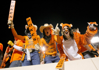 STILLWATER, OK - NOVEMBER 27:  Oklahoma State Cowboy fans cheer on their team as the Cowboys prepare to take on the Oklahoma Soones at Boone Pickens Stadium on November 27, 2010 in Stillwater, Oklahoma.  (Photo by Tom Pennington/Getty Images)