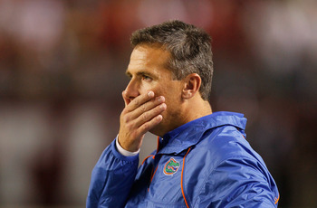TUSCALOOSA, AL - OCTOBER 02:  Head coach Urban Meyer of the Florida Gators looks on from the sidelines during their game against the Alabama Crimson Tide at Bryant-Denny Stadium on October 2, 2010 in Tuscaloosa, Alabama.  (Photo by Kevin C. Cox/Getty Imag