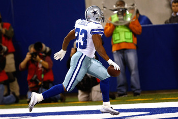INDIANAPOLIS, IN - DECEMBER 05: Tashard Choice #23 of the Dallas Cowboys runs in the end zone for a touchdown in the 1st quarter against the Indianapolis Colts at Lucas Oil Stadium on December 5, 2010 in Indianapolis, Indiana.  (Photo by Scott Boehm/Getty