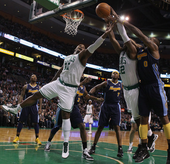 BOSTON, MA - DECEMBER 08:  Glen Davis #11 and Von Wafer #12 of the Boston Celtics fights for the rebound with Gary Forbes #0 of the Denver Nuggets on December 8, 2010 at the TD Garden in Boston, Massachusetts. NOTE TO USER: User expressly acknowledges and