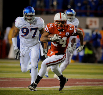 LINCOLN, NE - NOVEMBER 13: Niles Paul #24 of the Nebraska Cornhuskers runs past Richard Johnson Jr. #97 of the Kansas Jayhawks during first half action of their game at Memorial Stadium on November 13, 2010 in Lincoln, Nebraska. (Photo by Eric Francis/Get