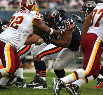 CHICAGO - OCTOBER 24: Chris Williams #74 of the Chicago Bears blocks Albert Haynesworth #92 of the Washington Redskins at Soldier Field on October 24, 2010 in Chicago, Illinois. The Redskins defeated the Bears 17-14. (Photo by Jonathan Daniel/Getty Images