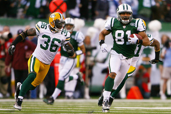 EAST RUTHERFORD, NJ - OCTOBER 31:  Dustin Keller #81 of the New York Jets runs with the ball while Nick Collins #36 of the Green Bay Packers chases him on October 31, 2010 at the New Meadowlands Stadium in East Rutherford, New Jersey. The Packers defeated