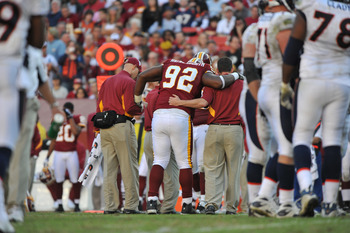LANDOVER, MD - NOVEMBER 15:  Albert Haynesworth #92 of the Washington Redskins is helped off the field during the game against the Denver Broncos at FedExField on November 15, 2009 in Landover, Maryland. The Redskins defeated the Broncos 27-17. (Photo by