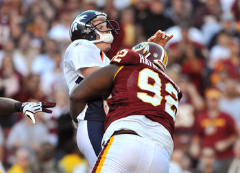 LANDOVER, MD - NOVEMBER 15:  Albert Haynesworth #92 of the Washington Redskins sacks Chris Simms #2 of the Denver Broncos at FedExField on November 15, 2009 in Landover, Maryland. The Redskins defeated the Broncos 27-17. (Photo by Larry French/Getty Image