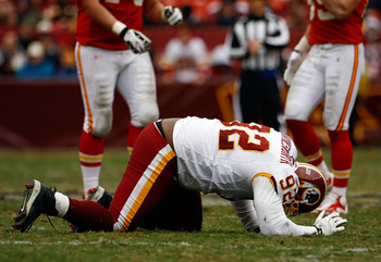 LANDOVER, MD - OCTOBER 18:  Albert Haynesworth #92 the Washington Redskins struggles to get off the field against the Kansas City Chiefs during their game October 18, 2009 at FedEx Field in Landover, Maryland. The Chiefs won the game 14-6.  (Photo by Win