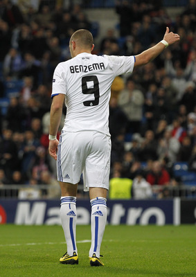 MADRID, SPAIN - DECEMBER 08:  Karim Benzema of Real Madrid celebrates after scoring Real's opening goal during the Champions League group G match between Real Madrid and AJ Auxerre at Estadio Santiago Bernabeu on December 8, 2010 in Madrid, Spain.  (Photo