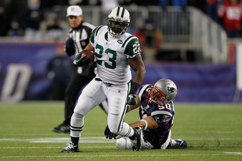 FOXBORO, MA - DECEMBER 06:  Shonn Greene #23 of the New York Jets runs the ball in the first half against Rob Ninkovich #50 of the New England Patriots at Gillette Stadium on December 6, 2010 in Foxboro, Massachusetts.  (Photo by Jim Rogash/Getty Images)