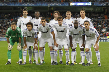 MADRID, SPAIN - DECEMBER 08: The Real Madrid team line up prior to the Champions League group G match between Real Madrid and AJ Auxerre at Estadio Santiago Bernabeu on December 8, 2010 in Madrid, Spain. (Photo by Angel Martinez/Getty Images)
